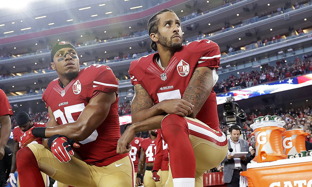 FILE - Int his Monday, Sept. 12, 2016, file photo, San Francisco 49ers safety Eric Reid (35) and quarterback Colin Kaepernick (7) kneel during the national anthem before an NFL football game against the Los Angeles Rams in Santa Clara, Calif. Reid has resumed his kneeling protest for human rights during the national anthem, after joining then-teammate Kaepernick's polarizing demonstration last season. (AP Photo/Marcio Jose Sanchez, File) ORG XMIT: NYHK702