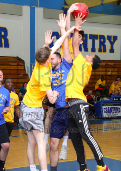 Mr. Corazza Goes Down with the Faculty in Senior Basketball Game